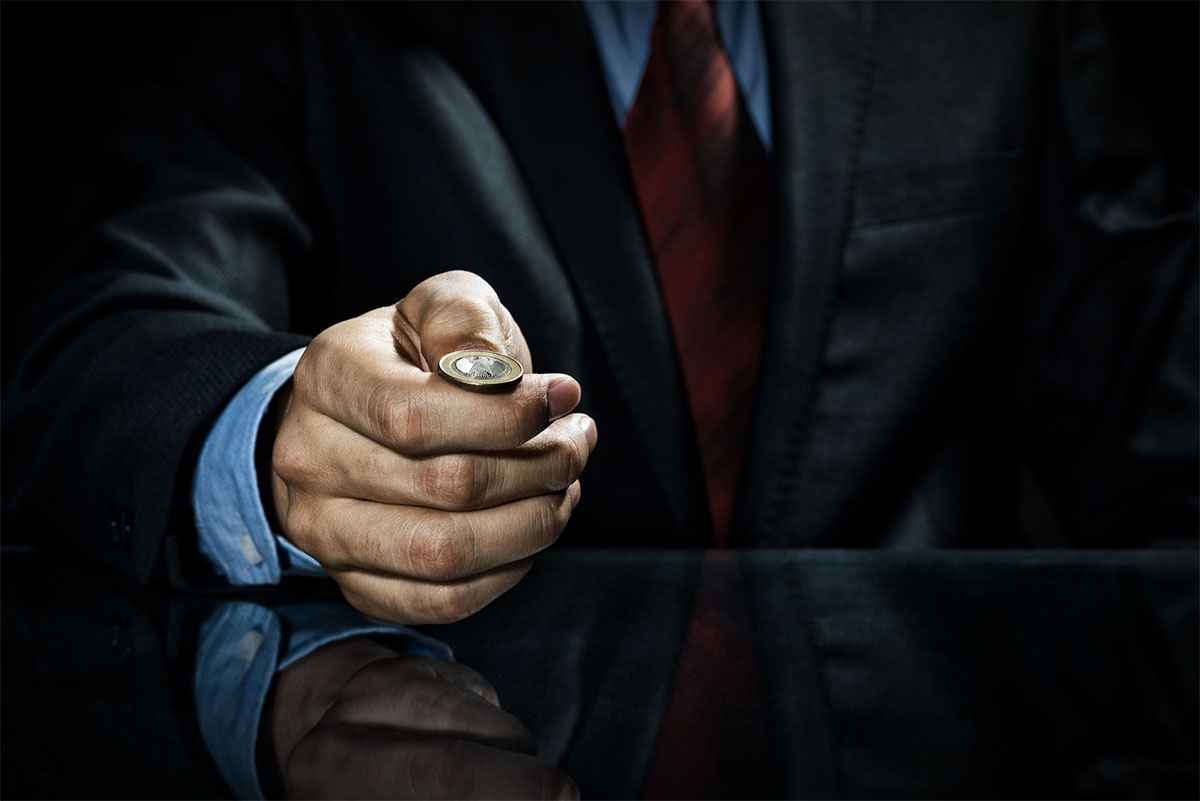 36260582 - close up of businessman holding coin in hand
