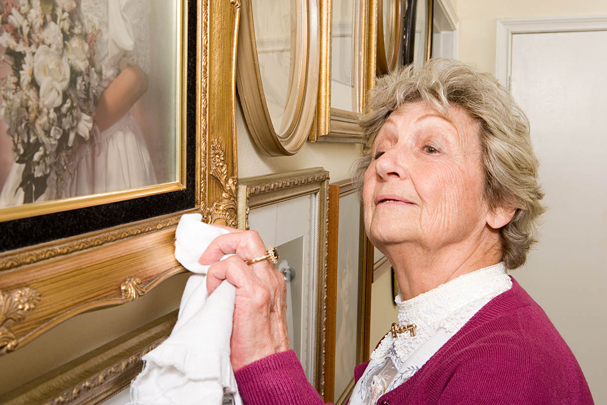49847923 - woman polishing picture frames
